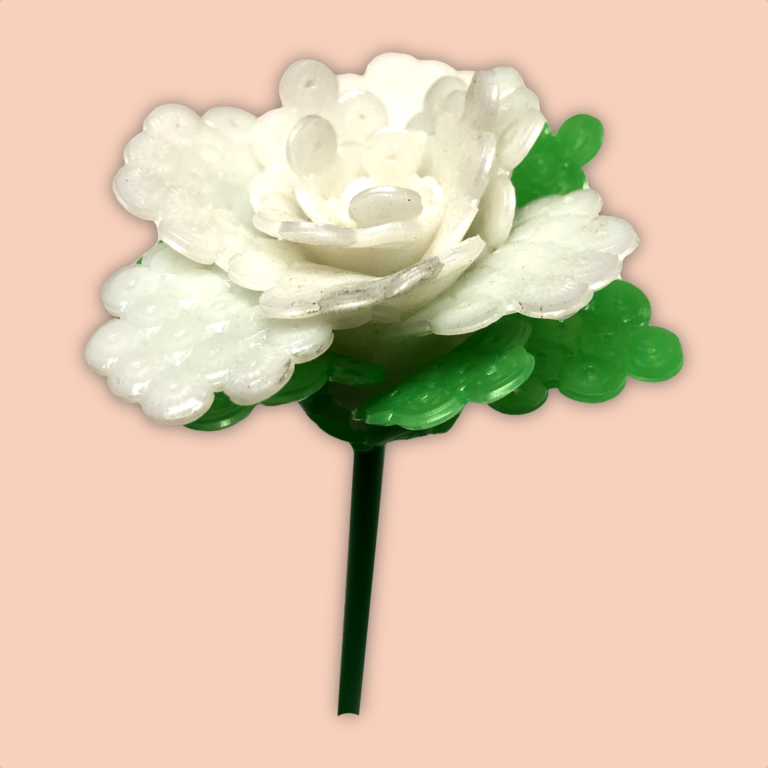 White rose made with hard melted beads