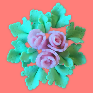 Flower bouquet with pink roses and green leaves