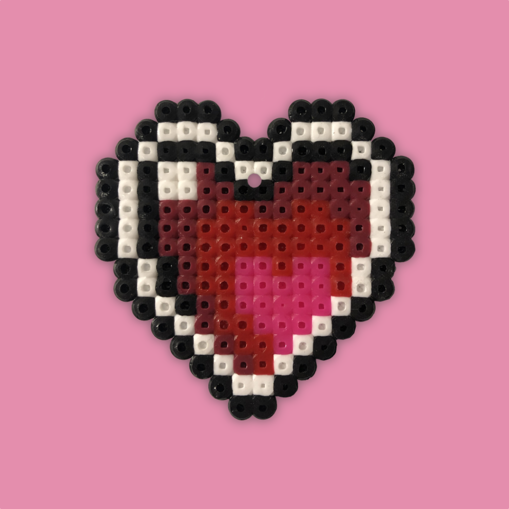 Pink and red heart shape with white and black border