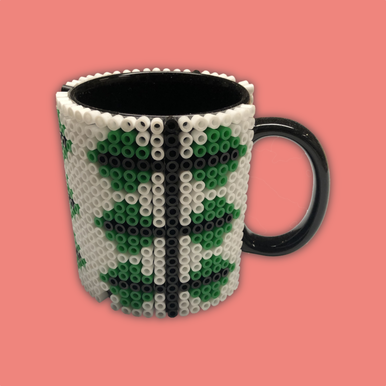 Coffee cup adorned with beads