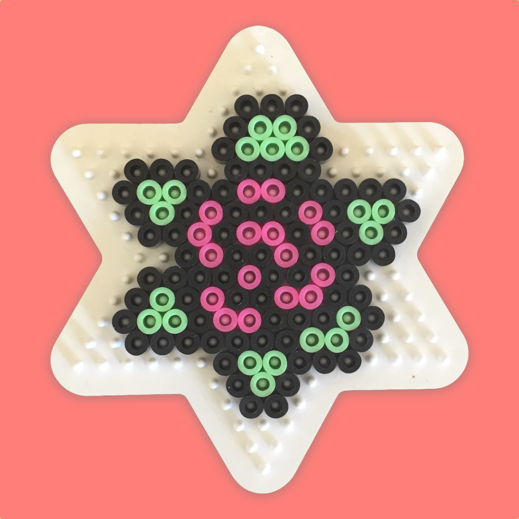 Rose made on a star-shaped pegboard